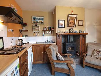 Fitted kitchen and solid fuel stove